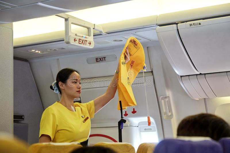 Air hostess demonstrate safety procedures. Bangkok Thailand, Jan 22 ,2019 , Airline nokscoot Interior of airplane with passengers on seats and stewardess in stock photos