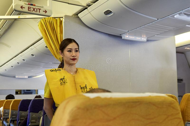 Air hostess demonstrate safety procedures. Bangkok Thailand, Jan 22 ,2019 , Airline nokscoot Interior of airplane with passengers on seats and stewardess in royalty free stock images