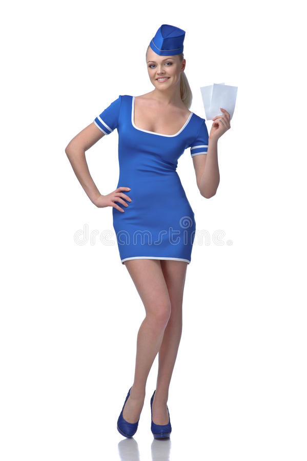 Air Hostess Holding Two Tickets To The Flight Royalty Free Stock Image