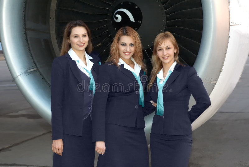 Air hostesses in front of engine stock photo