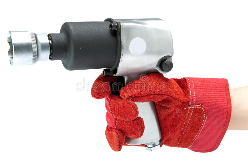 Air impact wrench. Hand in a working glove holds air impact wrench stock photos