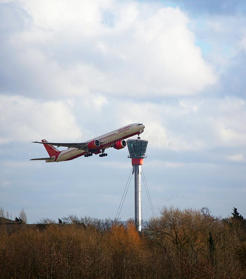 Air India Boeing 777 taking off at Heathrow Airport. Air India Boeing 777 taking off in front of the control tower at Heathrow airport royalty free stock photos