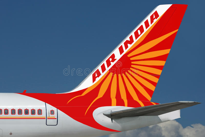 Air India plane. Air India logo is on the tail of plane, close-up & on the beautiful blue sky background. The sky area is free for your text royalty free stock photo