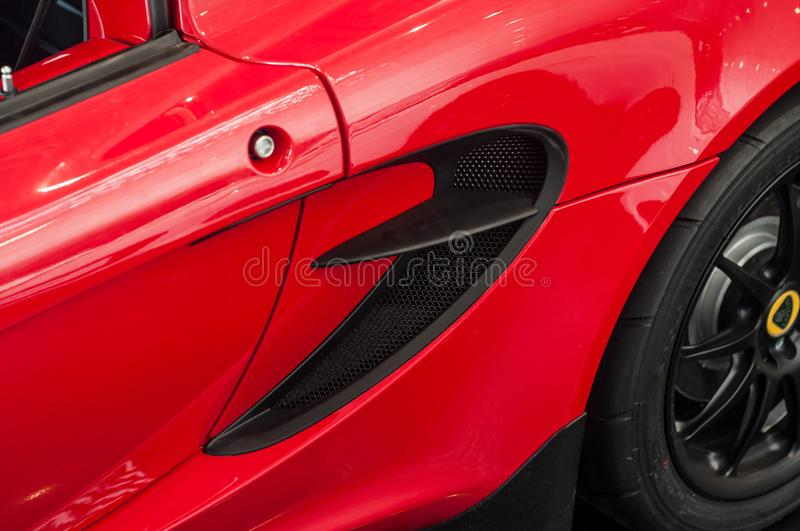 Air inlet on red Lotus Elise at retailer showroom. Mulhouse - France - 9 October 2019 - Closeup of air inlet on red Lotus Elise at retailer showroom stock photography