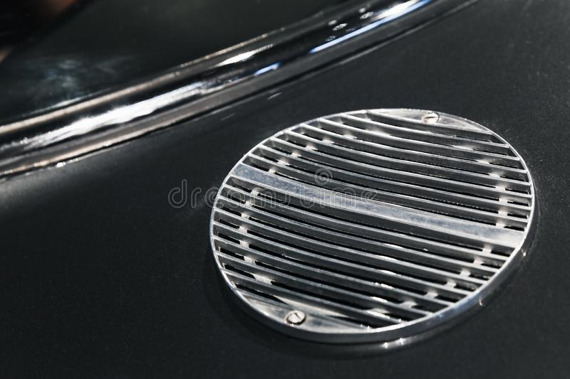 Air intake grille. Luxury vintage sports car. Fragment, close up photo with selective soft focus stock photography