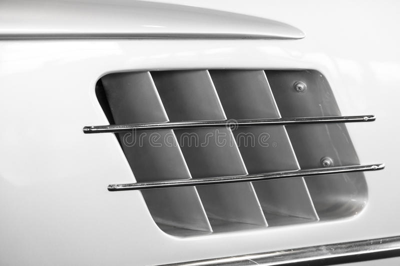The air intake of a sports car. Detail of the air intake of a sports car royalty free stock photos