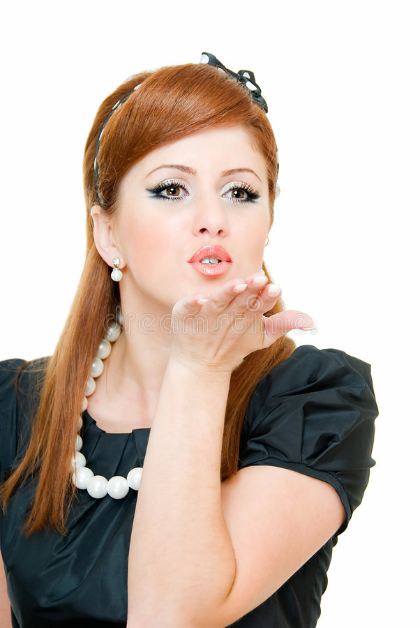 Air kiss. Young beauty redheaded woman sends air kiss stock images