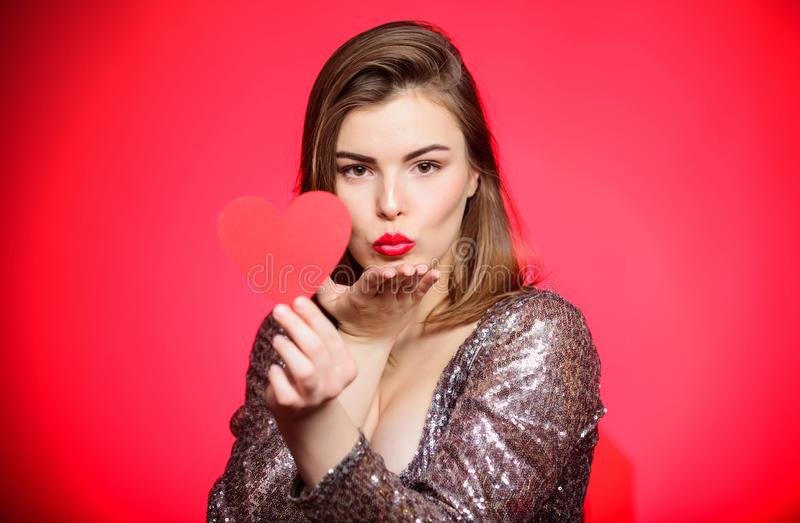 Air kiss. Love you so much. Woman attractive kiss face send love to you. Valentines day and romantic mood. Tender kiss. From lovely girl with makeup red lips stock photo