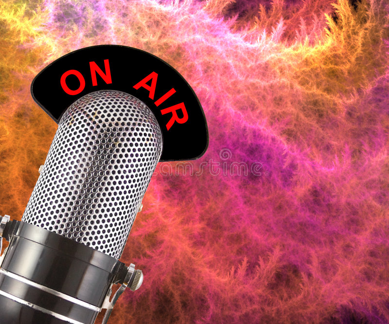 On Air Microphone. On Air vintage microphone over colourful smoke background stock photography