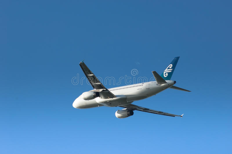 Air New Zealand A320. An Air New Zealand Airbus A320 passenger aircraft in flight against clear blue sky royalty free stock photos