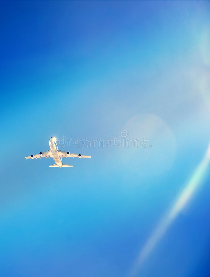 Air plane. View of air plane in blue sky from the cockpit royalty free stock photo