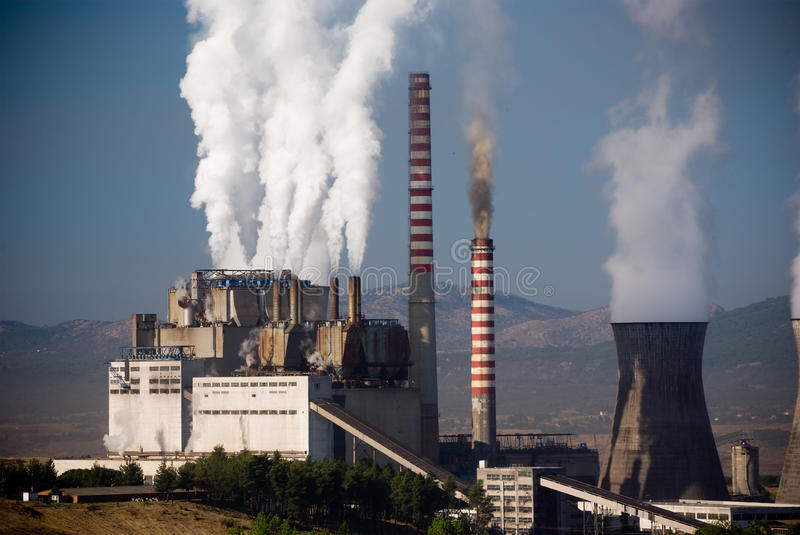 Air Pollution. Steaming smoke stack and cooling tower with pollution in Megalopolis, Greece royalty free stock images