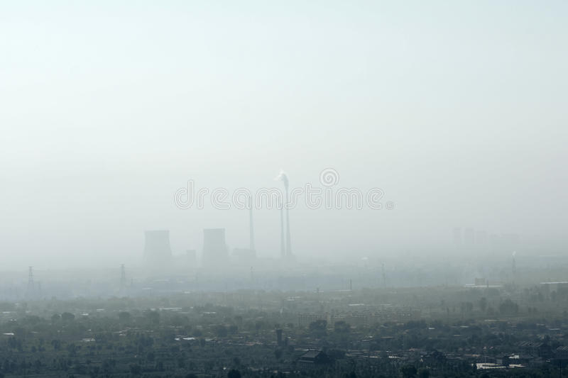 Air pollution. The polluted air hang over the factories and the earth royalty free stock photography