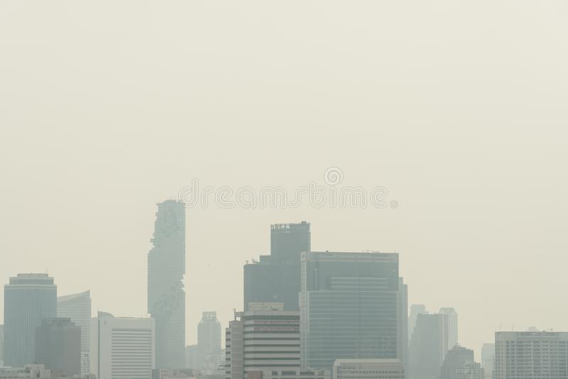 Air pollution effect made low visibility cityscape with haze and fog from dust in the air during sunset in Bangkok, Thailand stock photo