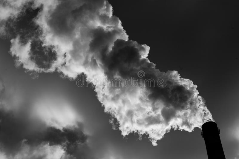 Air pollution. Harmful emissions. Bad ecology. Smoke from factory pipe Dirty smoke on the sky, ecology problems royalty free stock photography