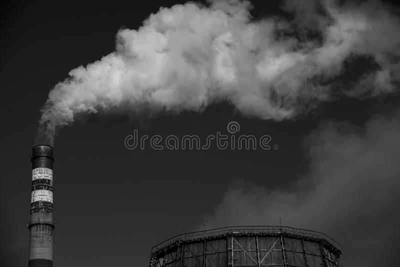 Air pollution. Harmful emissions. Bad ecology. Smoke from factory pipe Dirty smoke on the sky, ecology problems royalty free stock image