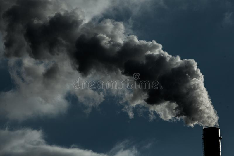 Air pollution. Harmful emissions. Bad ecology. Smoke from factory pipe Dirty smoke on the sky, ecology problems royalty free stock images