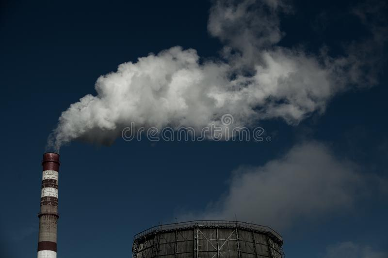 Air pollution. Harmful emissions. Bad ecology. Smoke from factory pipe Dirty smoke on the sky, ecology problems stock photos