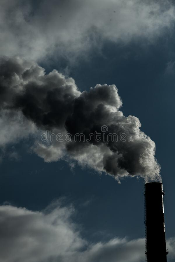 Air pollution. Harmful emissions. Bad ecology. Smoke from factory pipe Dirty smoke on the sky, ecology problems stock images