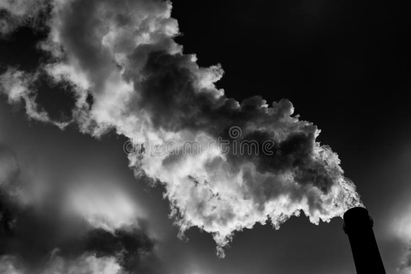 Air pollution. Harmful emissions. Bad ecology. Smoke from factory pipe Dirty smoke on the sky, ecology problems stock photography