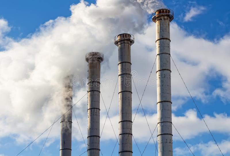 Air Pollution From Industrial Plants. Smoking industrial pipes stock images