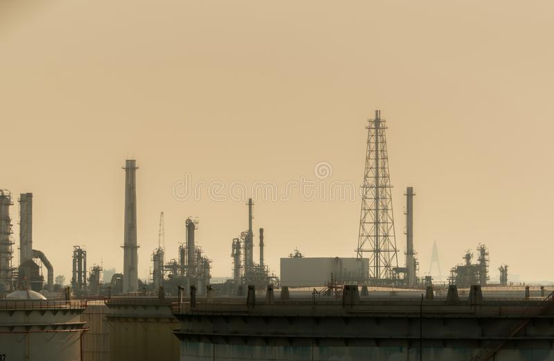 Air pollution at oil petroleum refinery plant. Bad air quality filled with dust. Global warming from air pollution problem. stock photo
