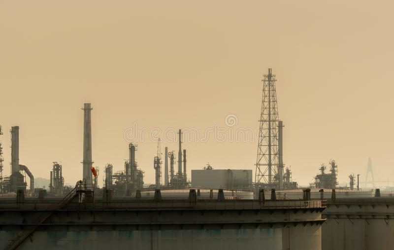 Air pollution at oil petroleum refinery plant. Bad air quality filled with dust. Global warming from air pollution problem. Environmental problem from gas stock photo