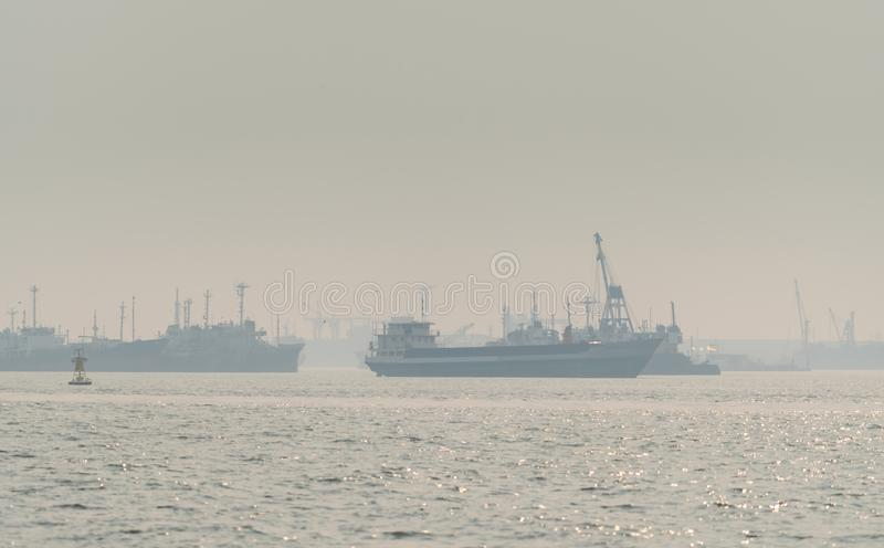 Air pollution at the pier. Bad air quality filled with dust causes of respiratory diseases. Global warming from air pollution. Problem. Environmental problem royalty free stock photography