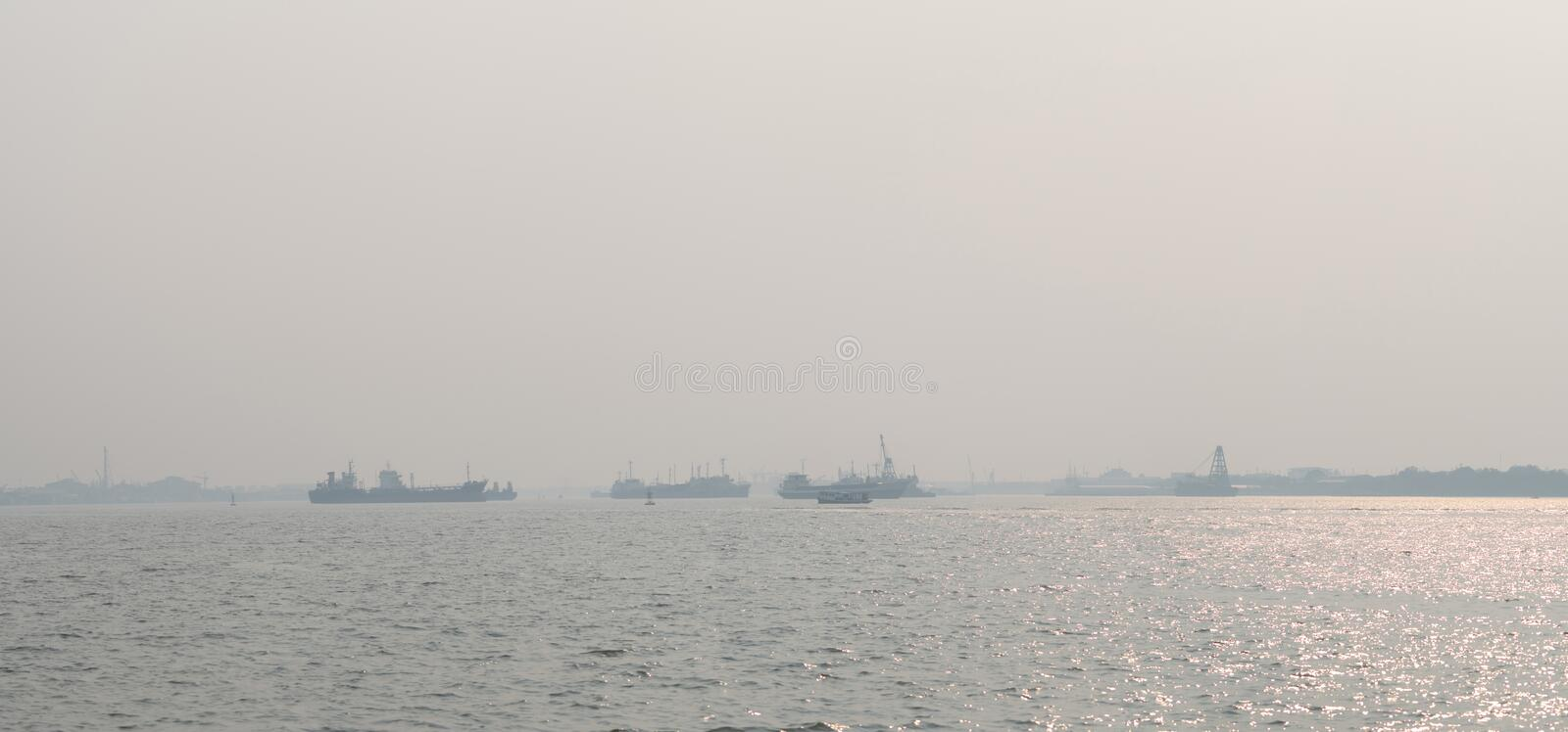 Air pollution at the pier. Bad air quality filled with dust causes of respiratory diseases. Global warming from air pollution. Problem. Environmental problem stock photo