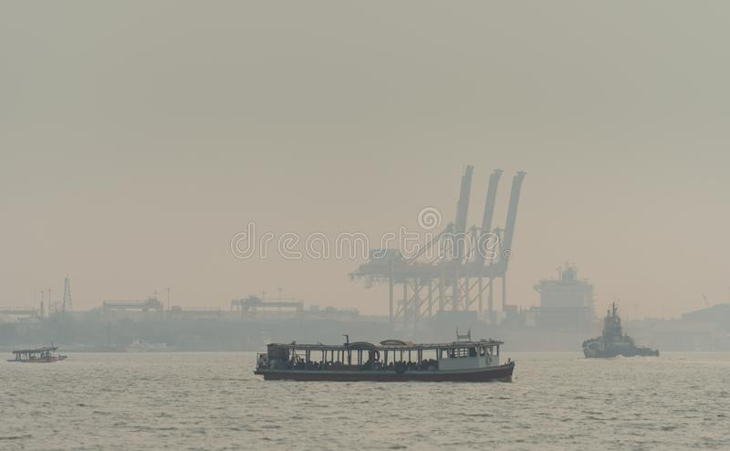 Air pollution at the pier. Bad air quality filled with dust causes of respiratory diseases. Global warming from air pollution. Problem. Environmental problem royalty free stock photo