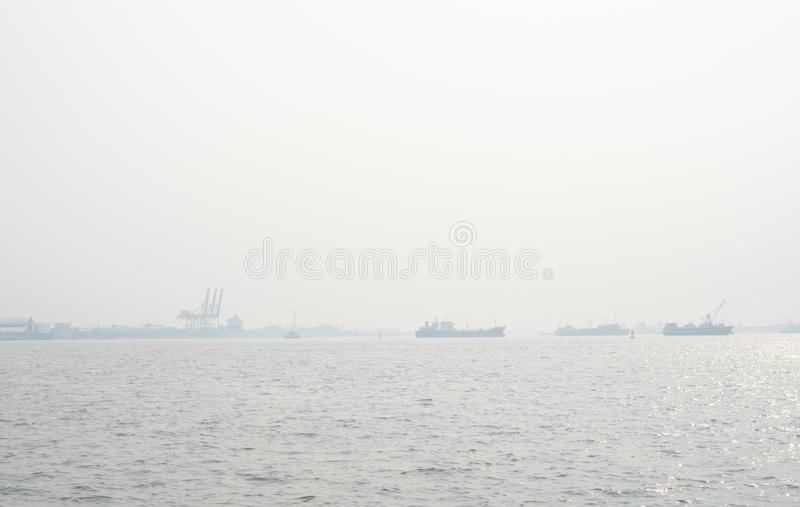 Air pollution at the pier. Bad air quality filled with dust causes of respiratory diseases. Global warming from air pollution. Problem. Environmental problem stock image