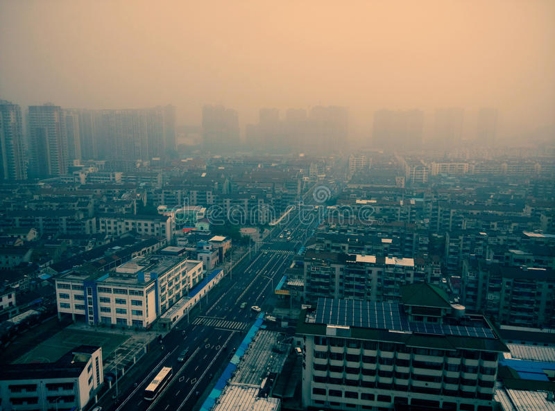 Air pollution of a regular city in china. Air pollution, or haze of a regular city in china royalty free stock photography