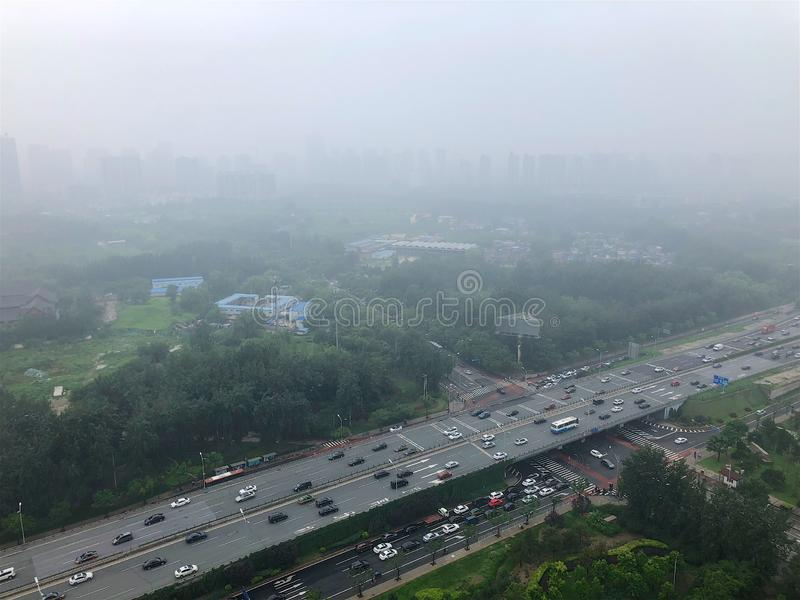 Top view highway with severe air pollution, fog and haze in Beijing city, China. royalty free stock photos