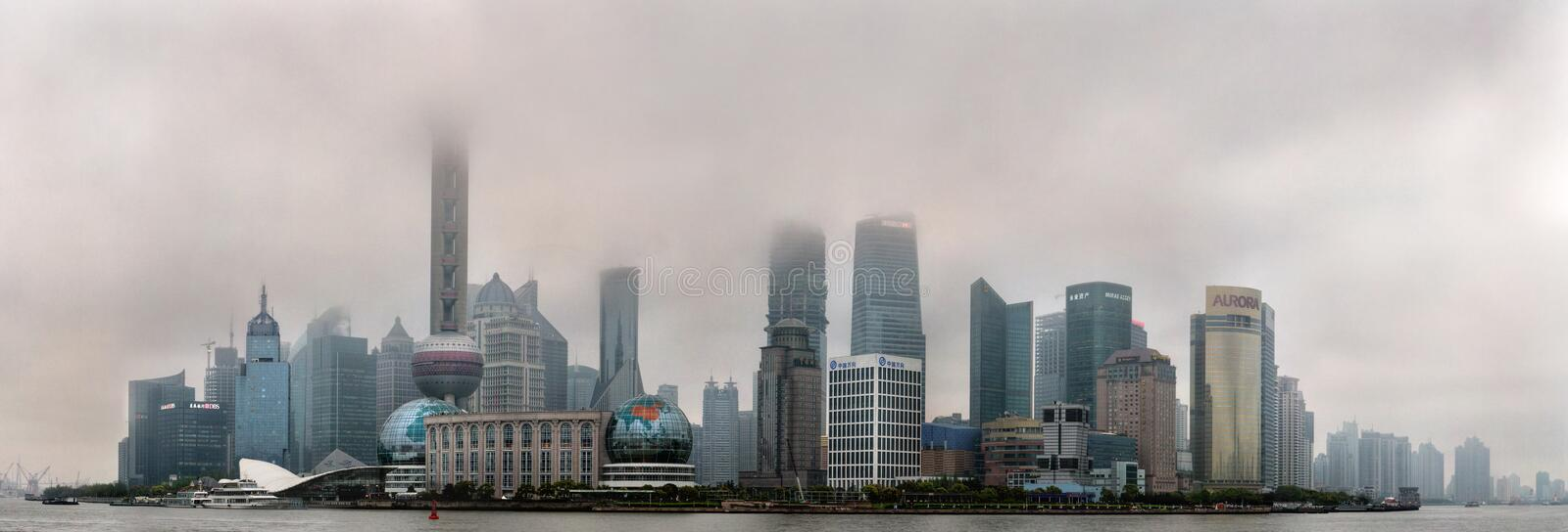 Air Pollution in Shanghai China Buildings are shrouded in smog. stock photo