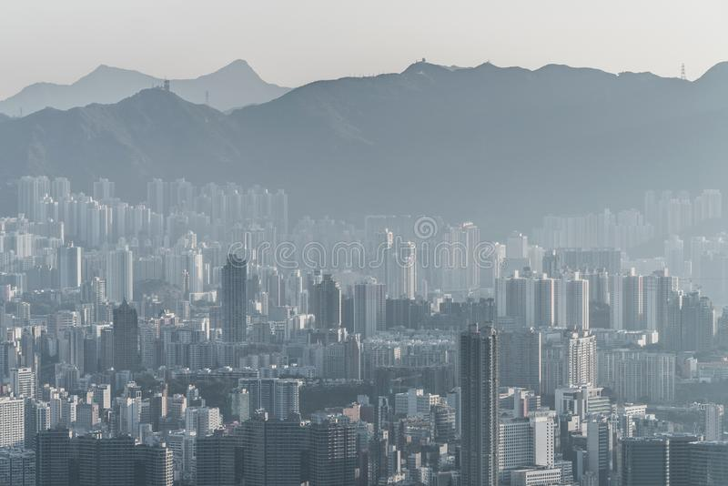 Air pollution in Hong Kong with Building in HongKong, China. Air pollution Smog in Hong Kong with Building and mountain in HongKong, China royalty free stock photo