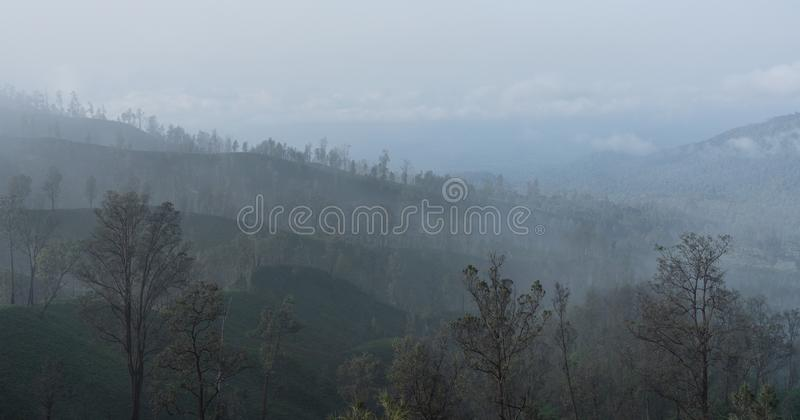 Air pollution, smog over forests near kawah Ijen volcanic in Indonesia royalty free stock photos