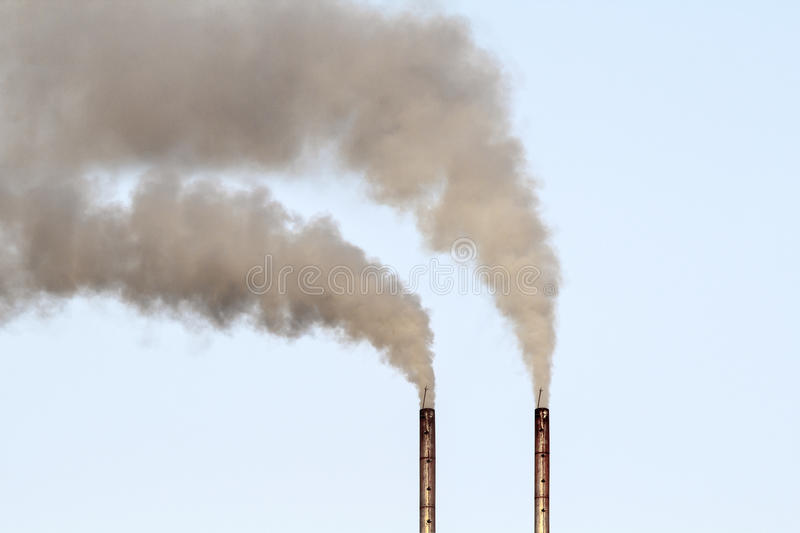 Air pollution by smoke coming out of factory royalty free stock photos