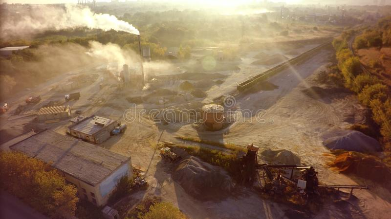 Air pollution by smoke coming out factory chimneys. Aerial royalty free stock images