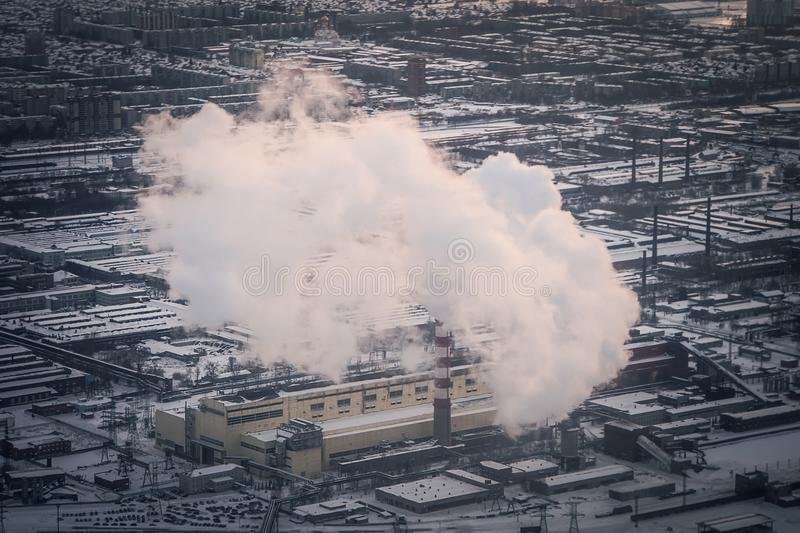Air pollution by smoke coming out of two factory chimneys. stock photos