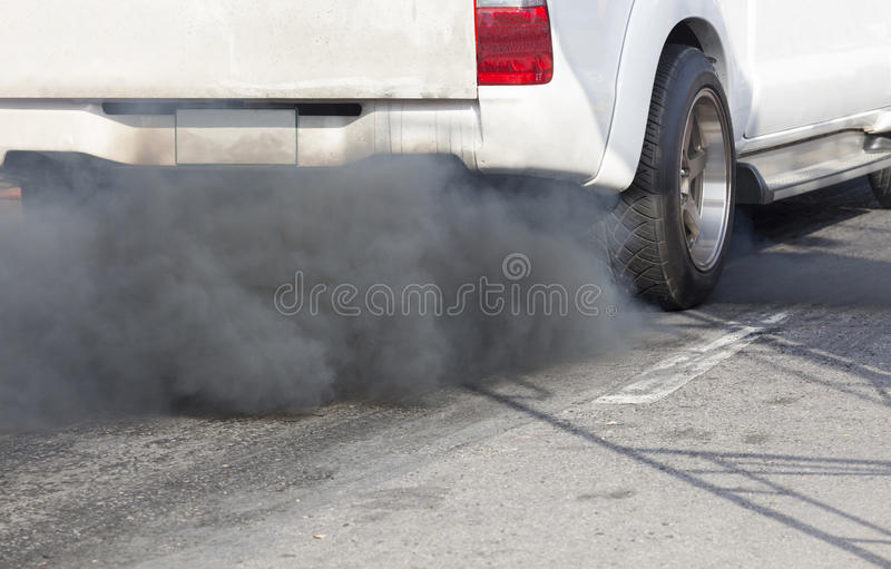 Air pollution from vehicle exhaust pipe. royalty free stock image