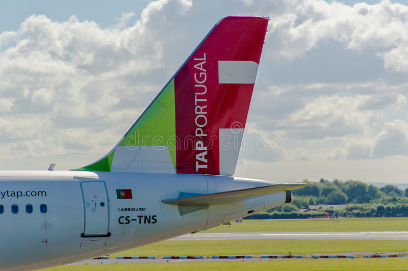 Air Portugal (TAP) Airbus A320 tail. MANCHESTER, UNITED KINGDOM - AUG 07, 2015: Air Portugal (TAP) Airbus A320 tail livery at Manchester Airport Aug 07 2015 royalty free stock photo