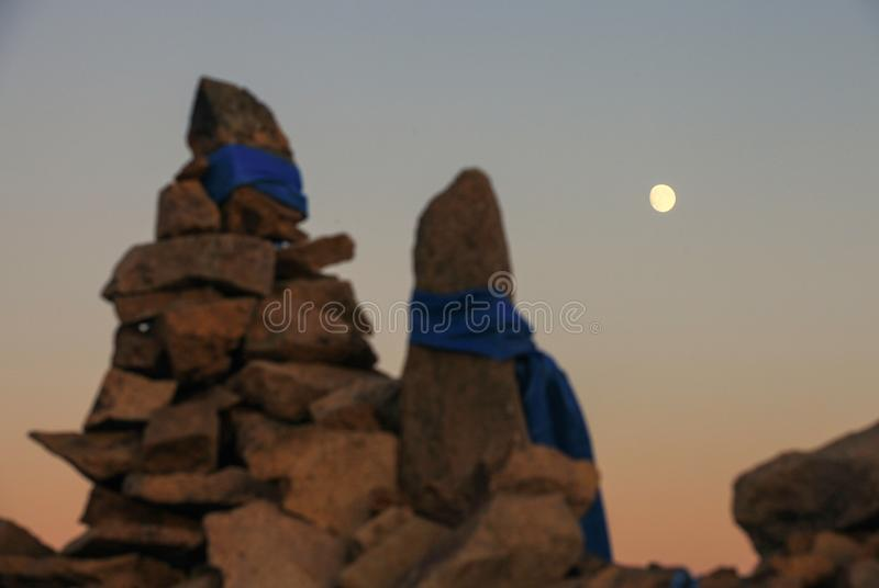 Moon in prairie in Wulanbutong in Inner Mongolia stock images