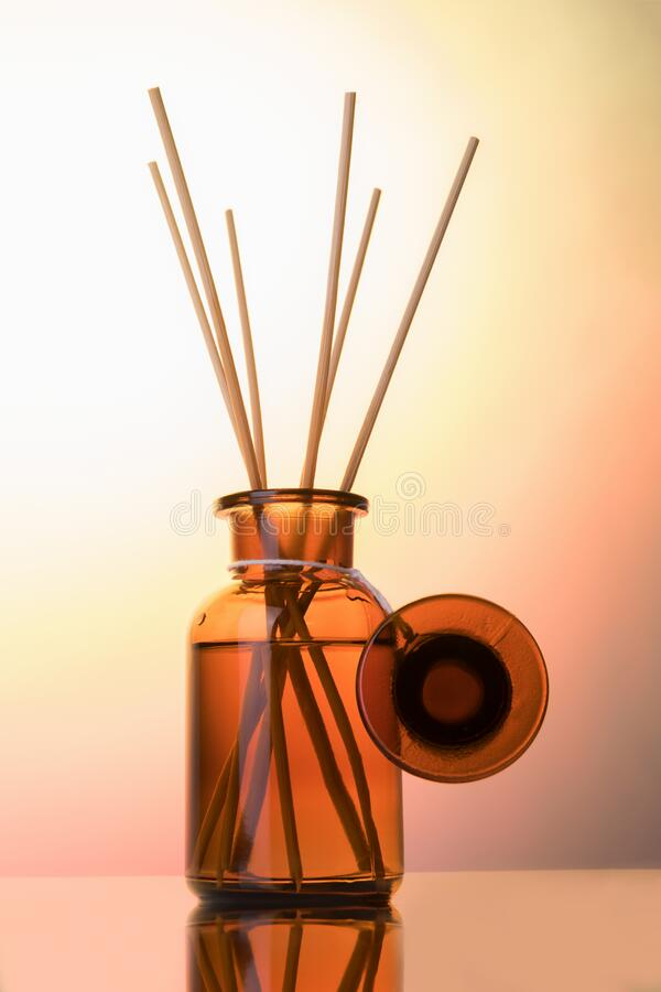 Free Air Refresher Bottle Mock Up, Reed Diffuser On A Light Rose Gradiente Background. Aromatherapy Concept. Home Fragrance Bottle Stock Images - 174790684