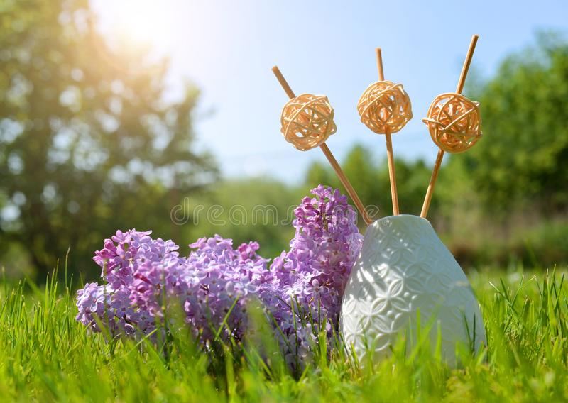 Air refresher bottle with sticks and lilac flowers. stock photos