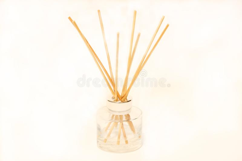 Air refresher bottle and wooden sticks isolated over white background royalty free stock photos