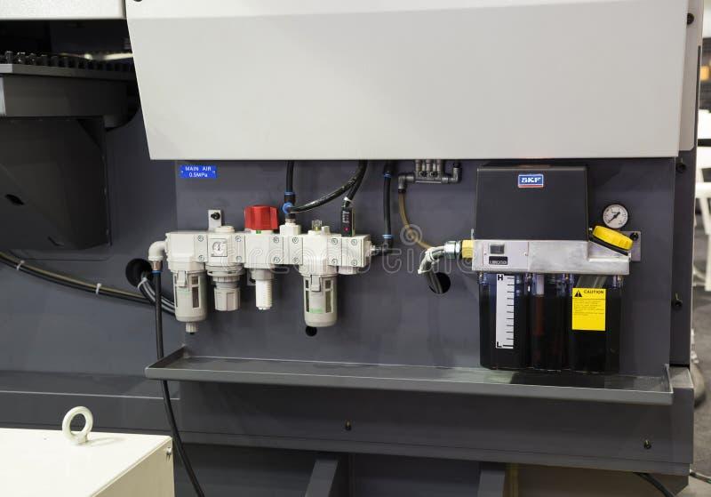 air regulator and lubrication oil tank stock image