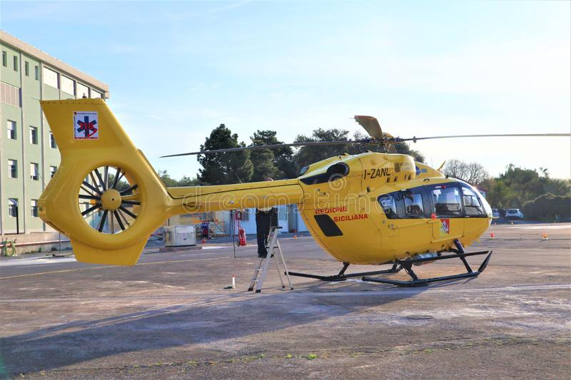 Air rescue service. Helicopter air ambulance on heliport stock image