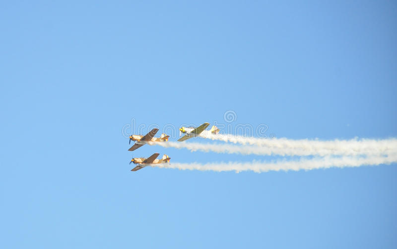 Air Show. Three planes flying toghetger on an air show stock images