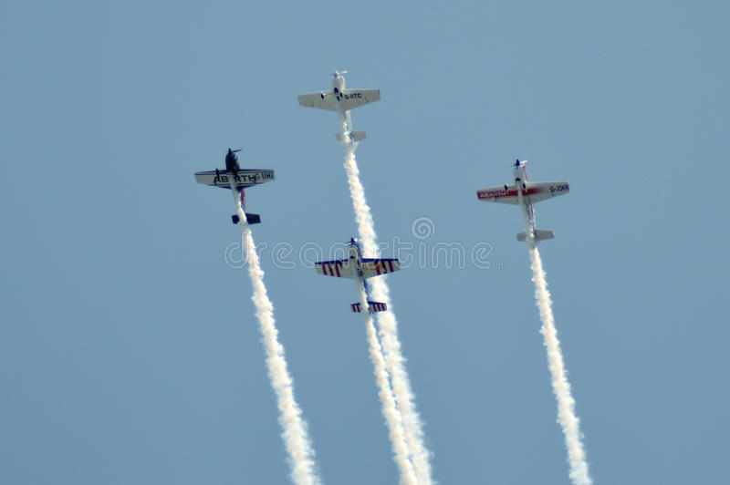 Air show at Ahmedabad, India. THE GLOBAL STARS Team of U.K. based British Acrobatics Champions had performed amazing formation with 4 air craft at Sabarmati royalty free stock photo