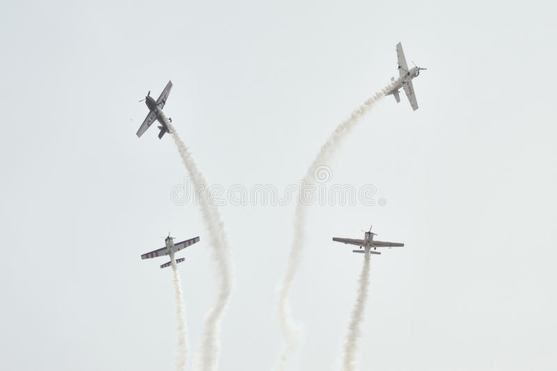 Air show at Ahmedabad, India. THE GLOBAL STARS Team of U.K. based British Acrobatics Champions had performed amazing formation with 4 air craft at Sabarmati royalty free stock image
